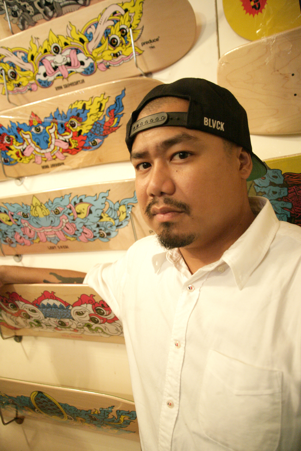 TRK of Preduce Skatboards Poses With His Designs.jpg