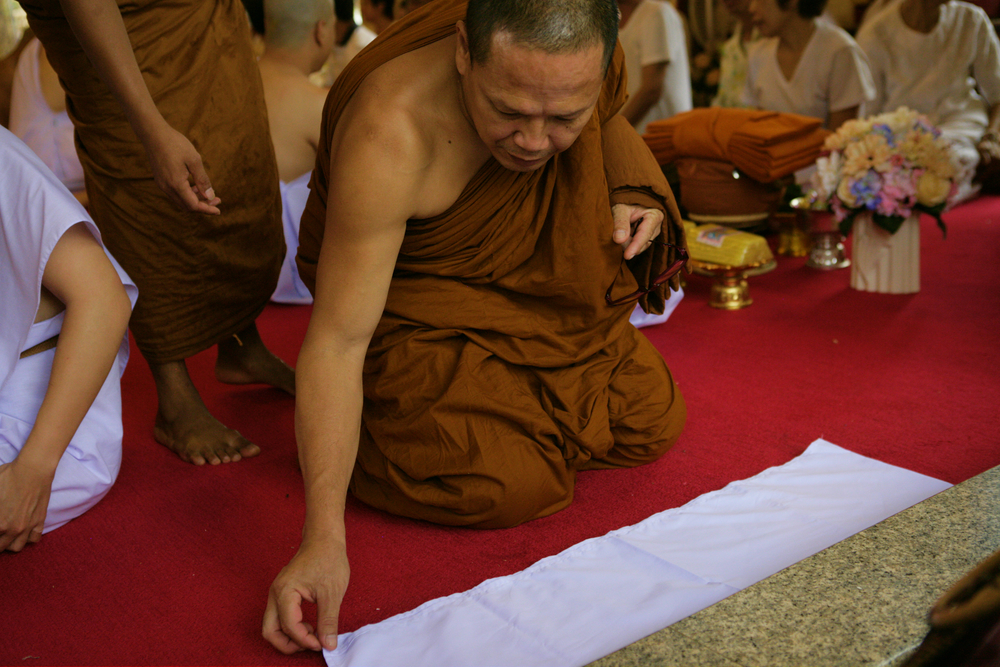 Head Monk Lays Sacred Cloth.jpg