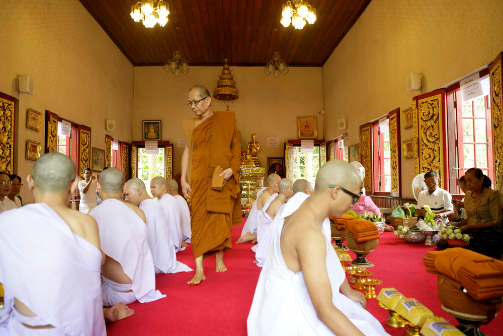Head Monk Walks Between Laymen.jpg