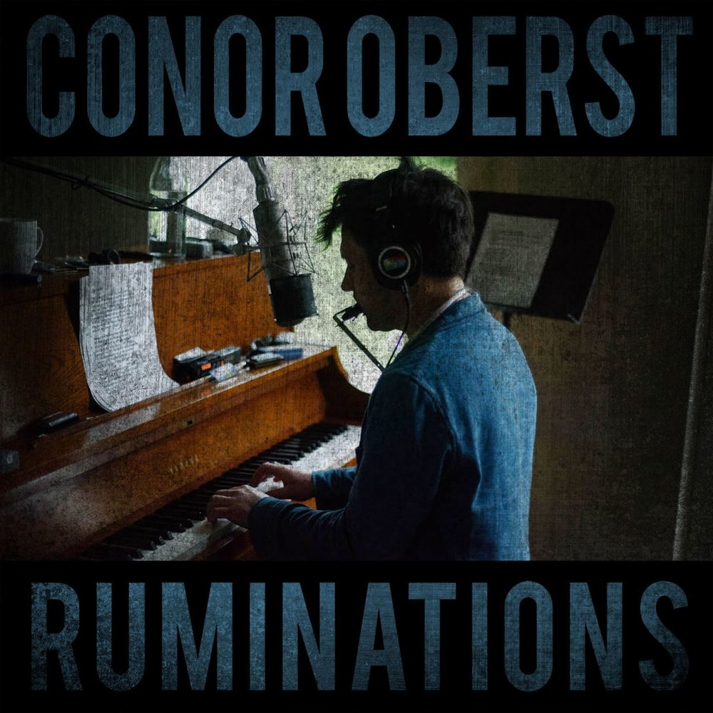 In a year of ups and downs, lefts and rights, and bewildering mix-ups, oddly everything still feels pretty normal. If not better. I have discovered that this is due to Conor Oberst releasing arguably his best project in 10 years earlier this year. A lot of spectacular music came out these last 12 months but I still find myself drifting back to Conor's sincere exposition. Ruminations is everything I've wanted in a new Oberst album from its raw style to poetic and introspective lyricism. I apologize in advance for this long winded blog post but I really wanted to convey the feeling of this album as it is my favourite of 2016.    Ruminations starts off with a little update into Conor's life these past couple of years.  Tachycardia  deals right away with the false rape accusation Conor underwent as well as some troubling health late 2015. As a long time listener, I am aware of many interviews where Conor breaths light into his personal struggle with depression and substance abuse and these recent events have definitely taken hold of that as is apparent in this song. Continuing the theme is the song  Barbary Coast , a song about temptations that surround Conor in his fame that could lead to rape accusations, troubles with fidelity and his wife. By the end of the song we realize that with all of these struggles Conor wants to remain around because his wife is always understanding and there for him when he returns home.  Gossamer Thin  is an extension of this idea through being spread too thin while feeling the pressure of remaining faithful among temptation, wanting to instill his honesty to his wife, and maintaining a performer's lifestyle. It all piles up and leads Conor back to his alcohol abuse time and time again. In his next song,  Counting Sheep , we hear a little more about his sickness and being bedridden flirting with thoughts of dying. Yet when his health is up, he finds himself following dated daily routine practices to try and stave of death without even know
