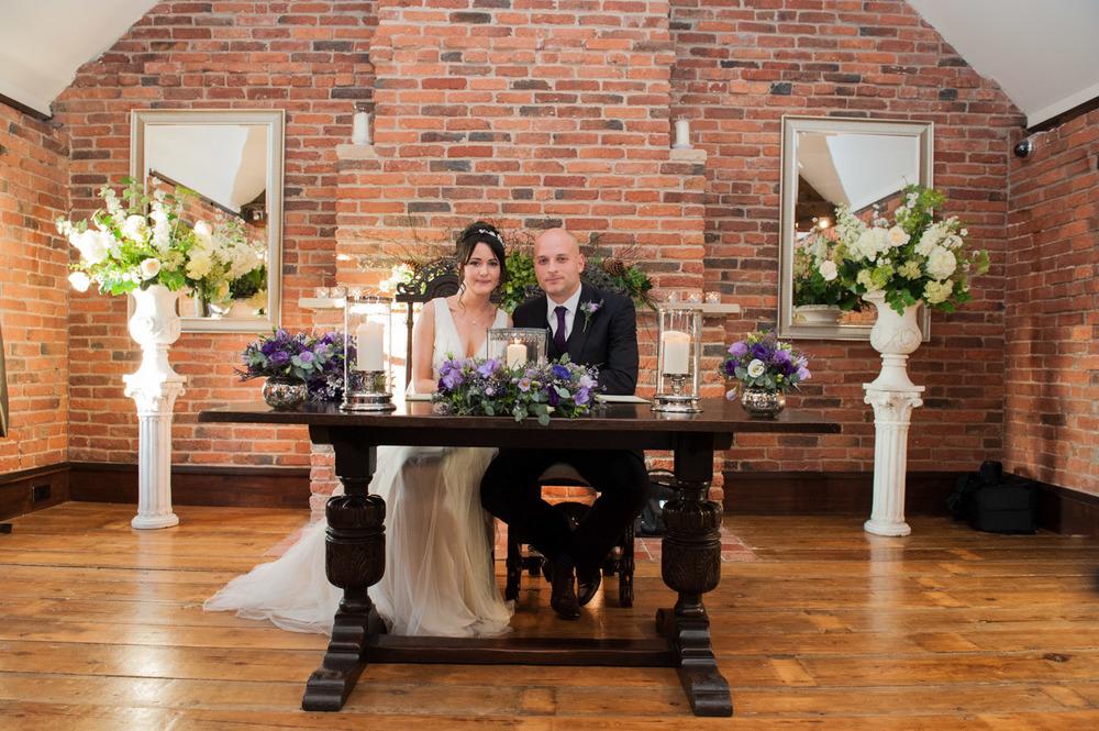 Signing the wedding register at Swancar Farm