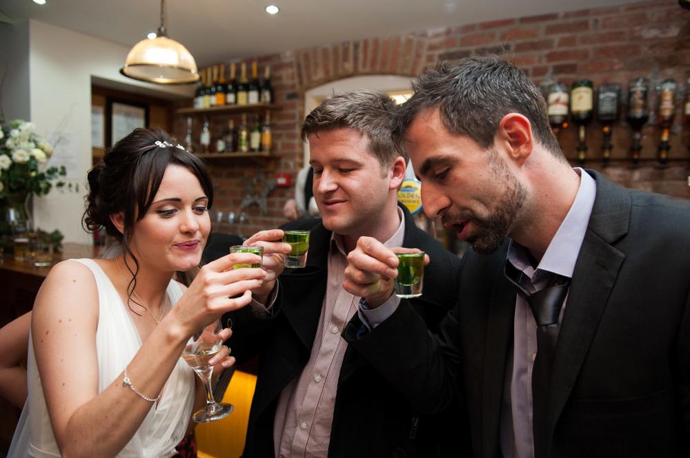 bride drinking shots at Swancar Farm wedding reception