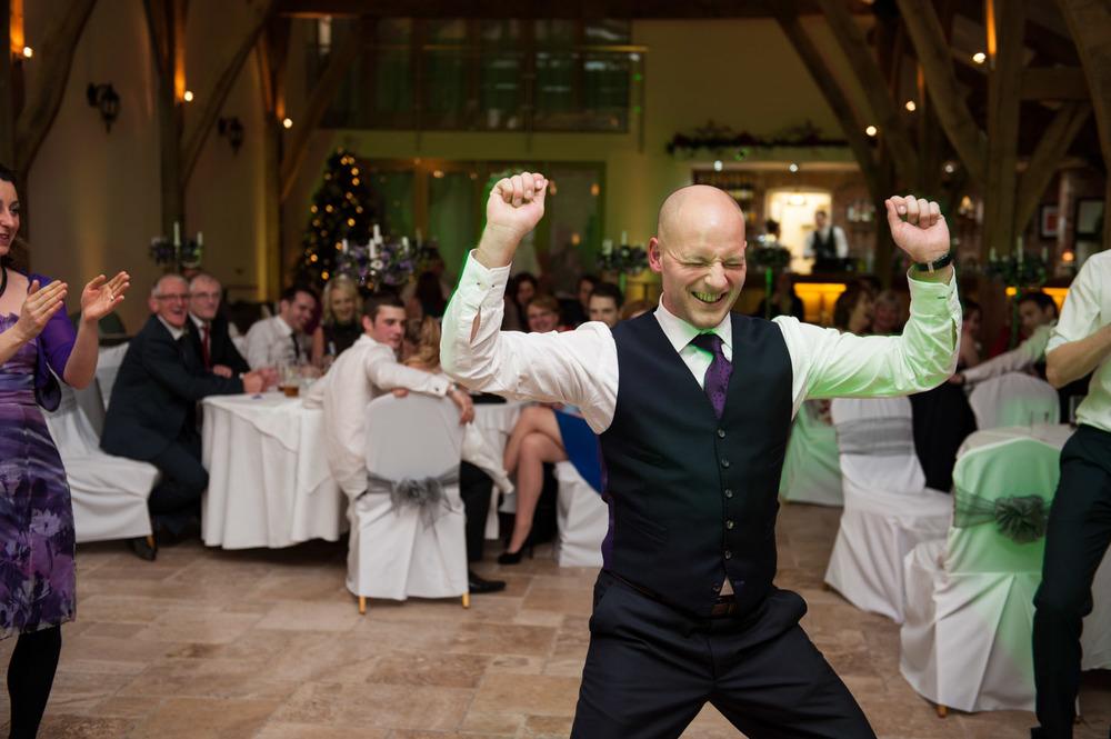 Groom dancing at Swancar Farm wedding