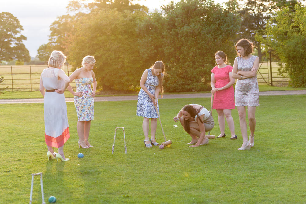 croquet on the lawns at Langar Hall wedding