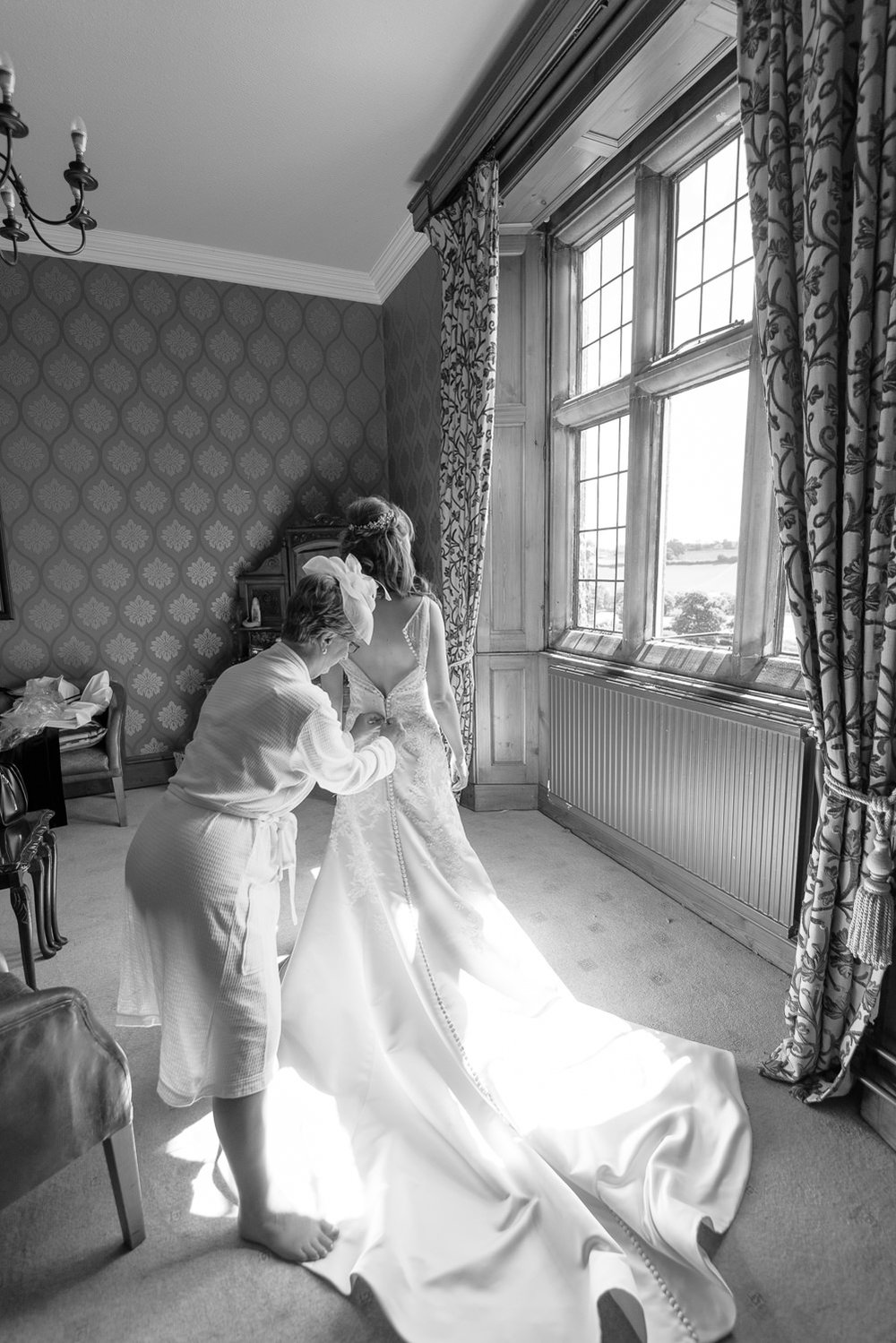 bride getting into her wedding dress at callow hall