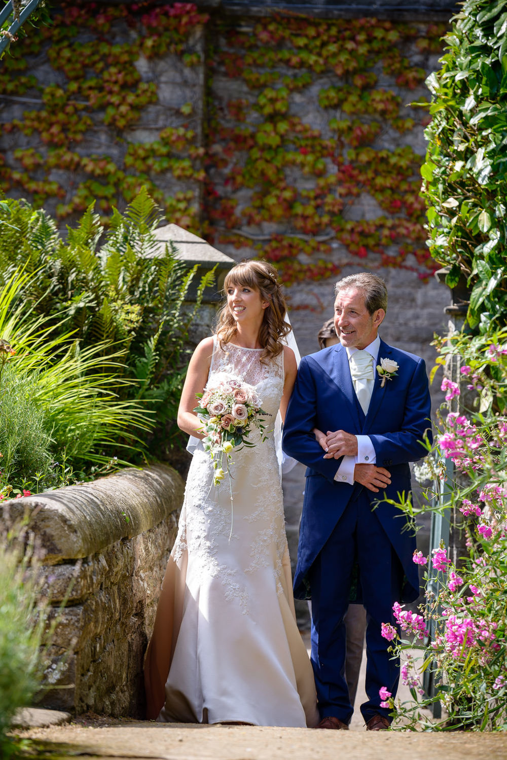 bride and her father walk down the aisle at Callow hall wedding