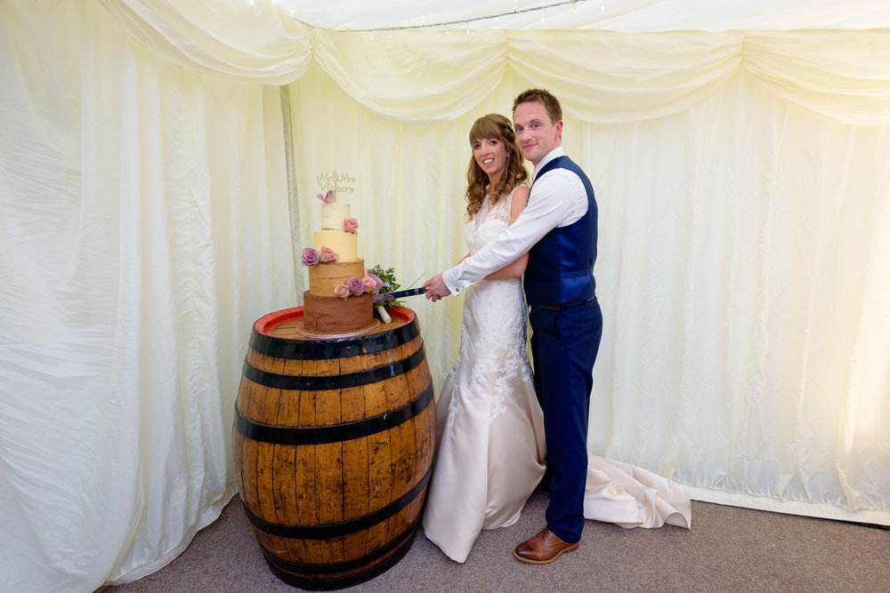 Bride and grrom cut wedding cake at Callow Hall wedding