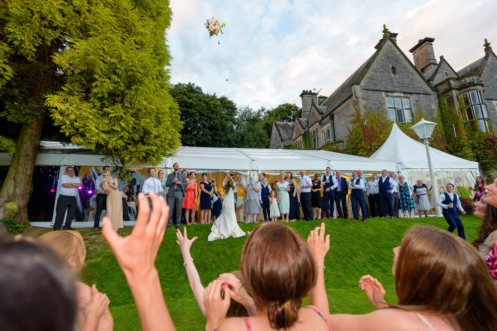 Bride throws her bouquet at Callow Hall