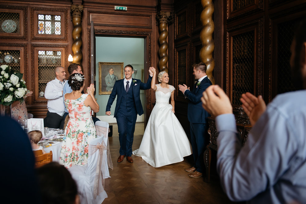 bride and grroms arrival into the great hall at burghley house