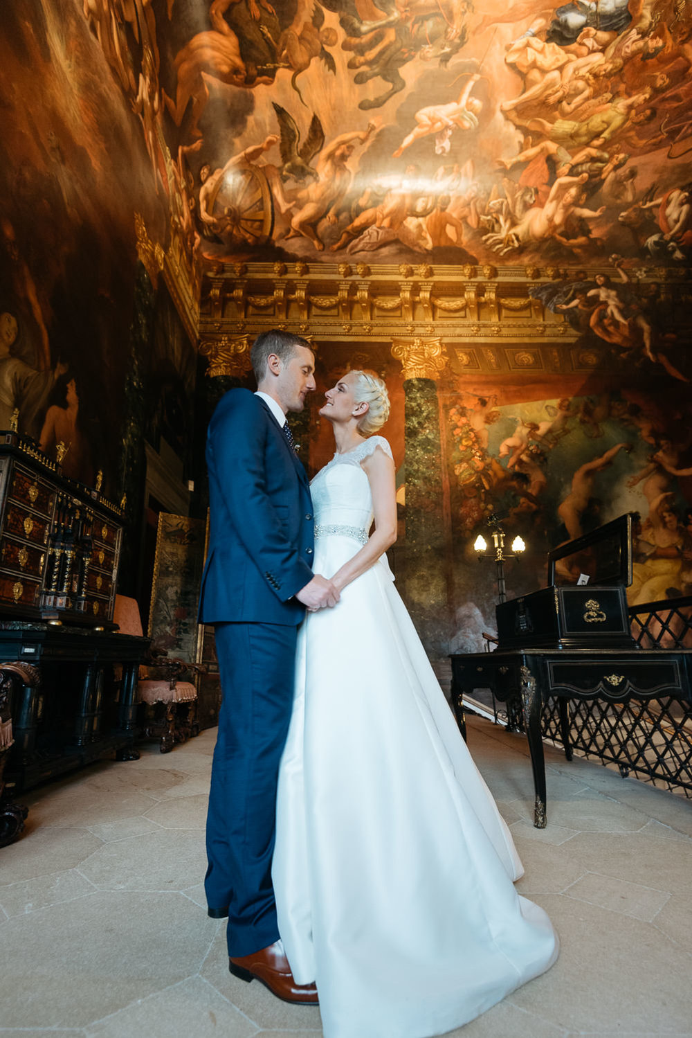 Bride and groom portrait on the hell staircase at Burghley Hose