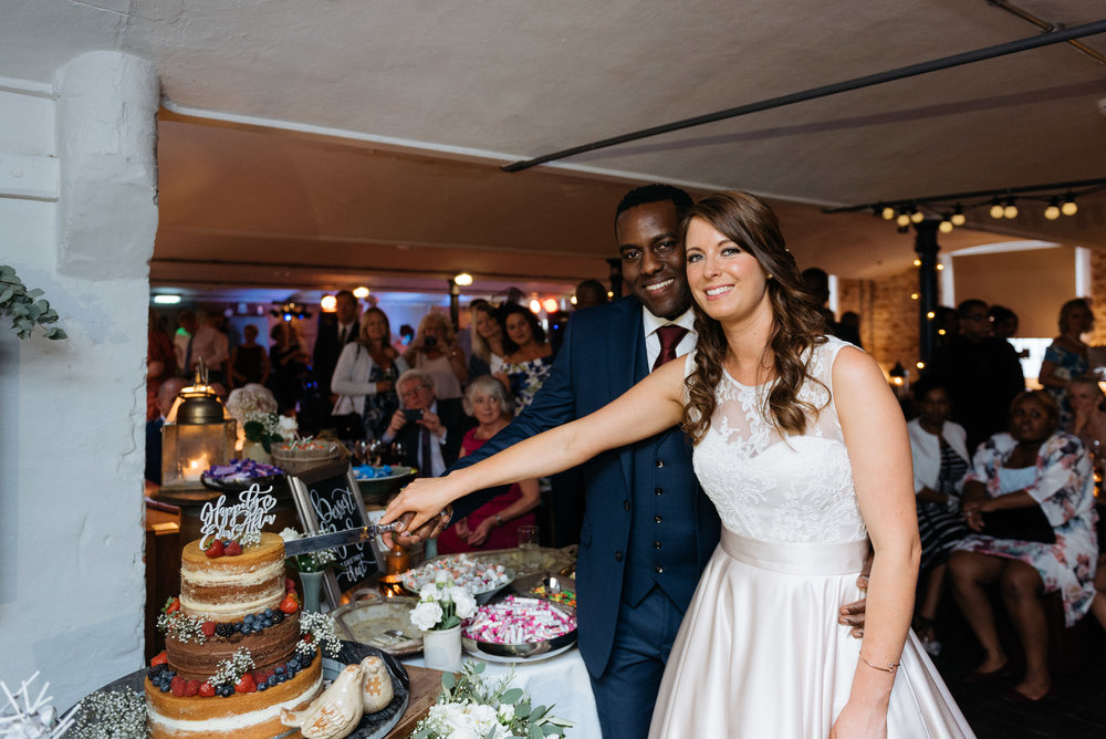 Cake cutting at The West Mill Wedding