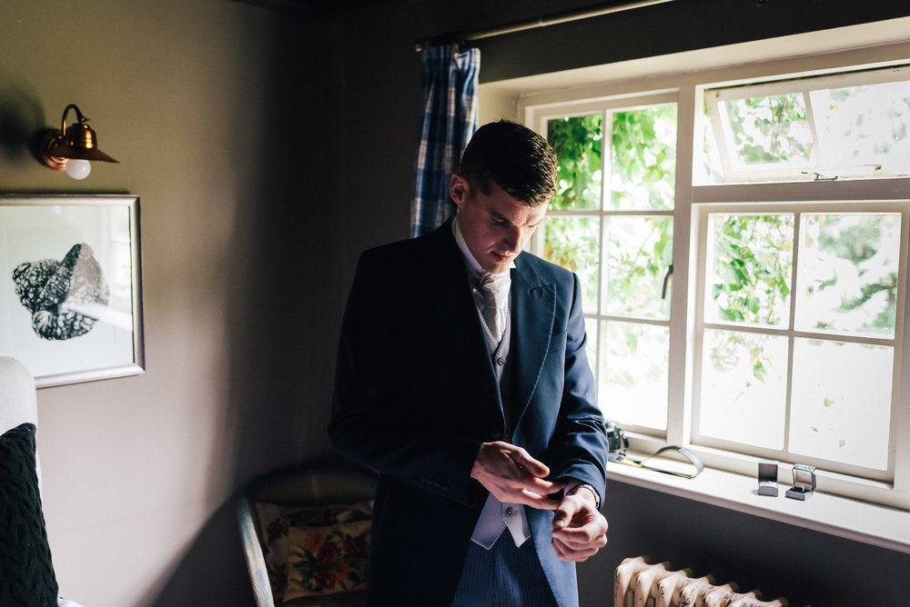 Groom getting ready at Narborough Hall Gardens