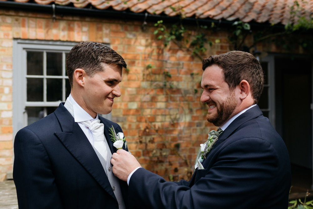 Groom and bestman at Narborough Hall Gardens