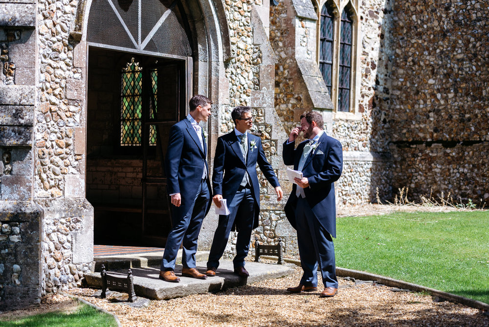 Groom and bestmen at church in Narborough