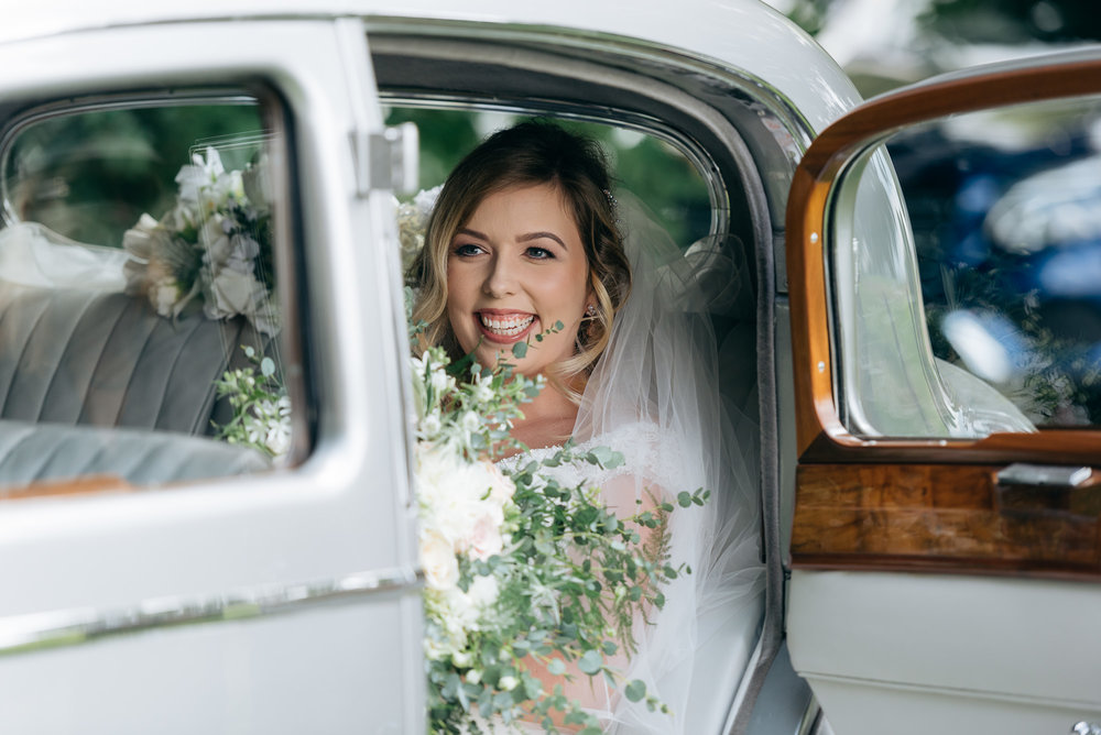 Bride arriving at Narborough Hall Gardens wedding