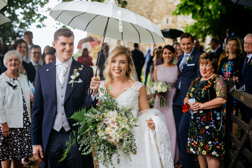 Bride and groom confetti throw at narborough hall gardens wedding