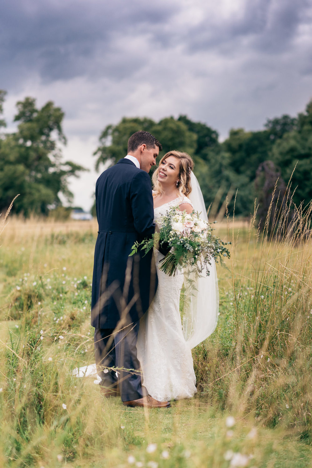 Portrait of the bride and groom at Narborough Hall Gardens in Norfolk