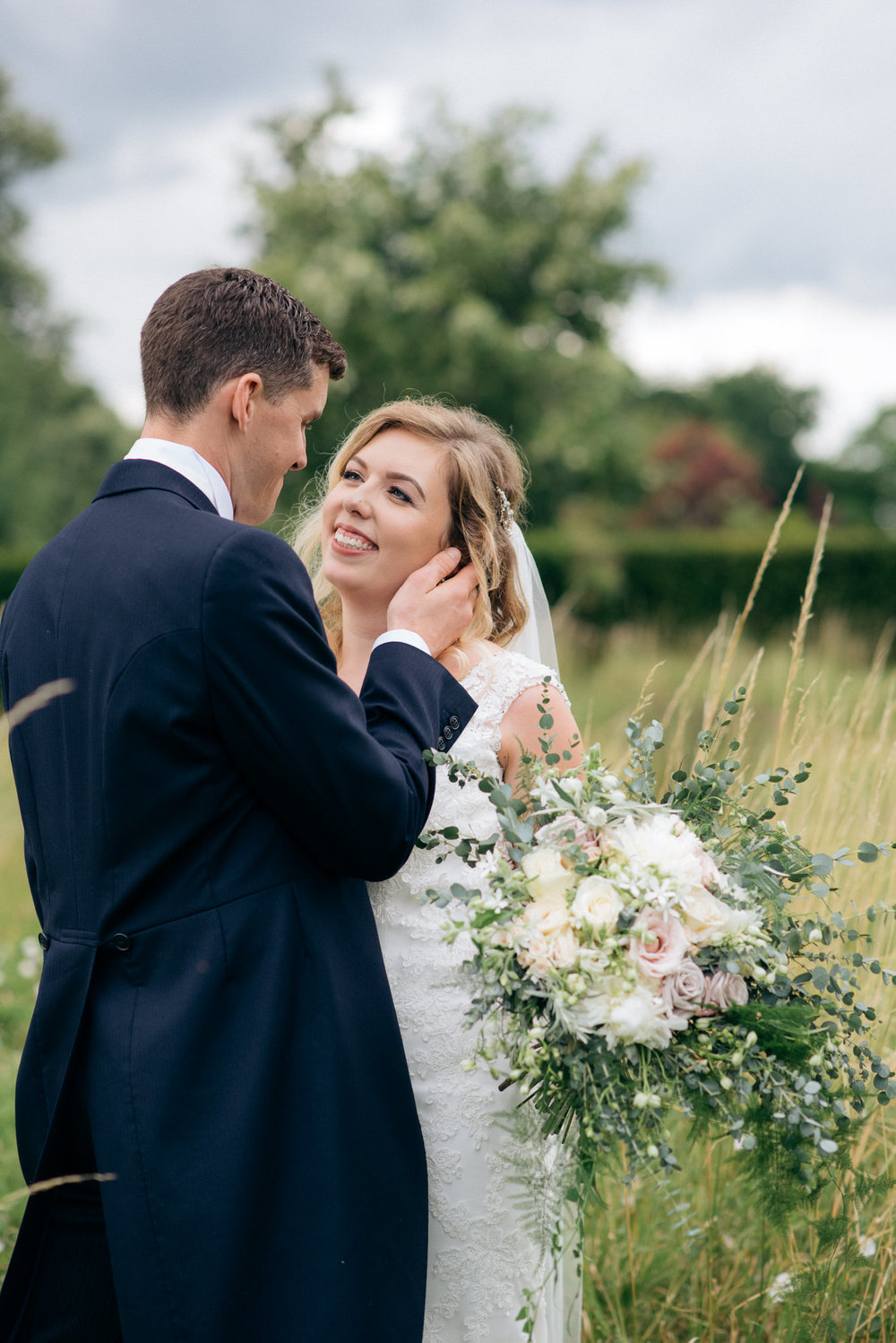 portrait of the bride and groom on their wedding day at Narborough Hall Gardens