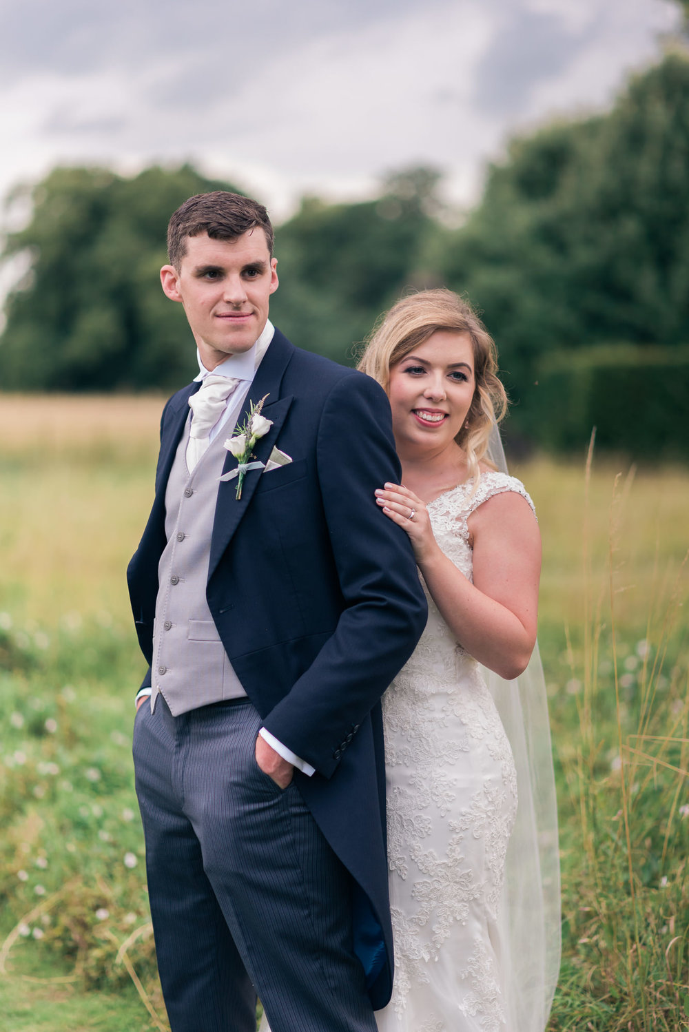 bride and groom on their wedding day at Narborough Hall Gardens in Norfolk