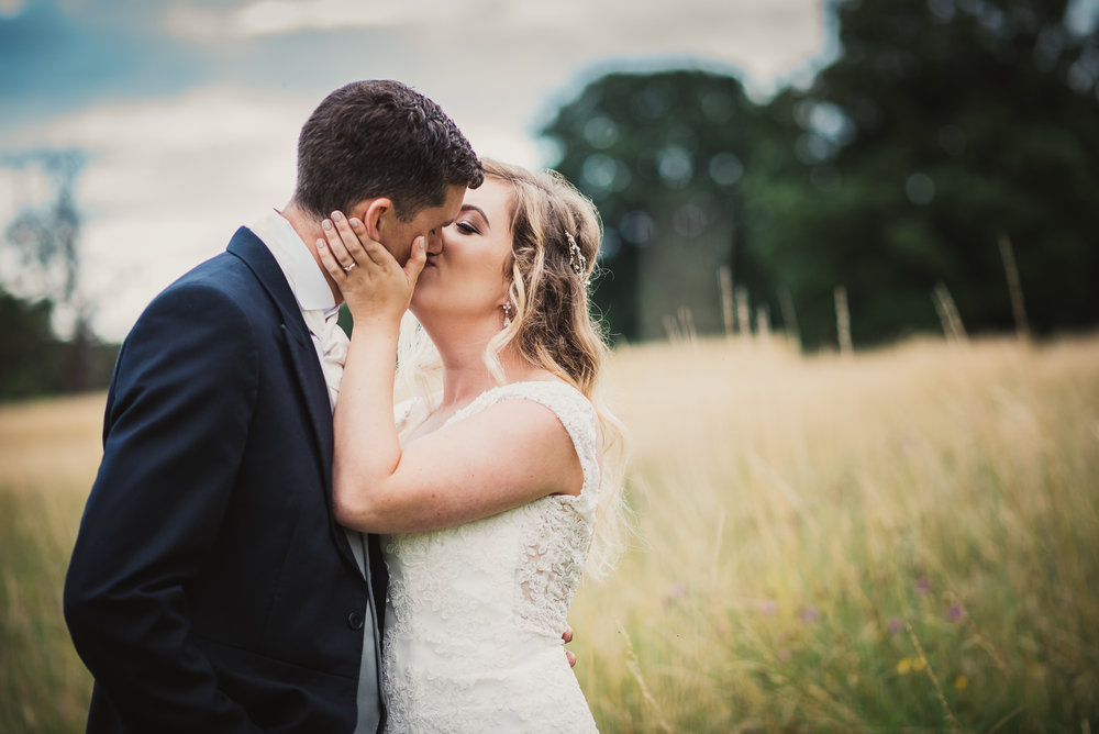 Bride and groom kissing at Narborough Hall Gardens Wedding