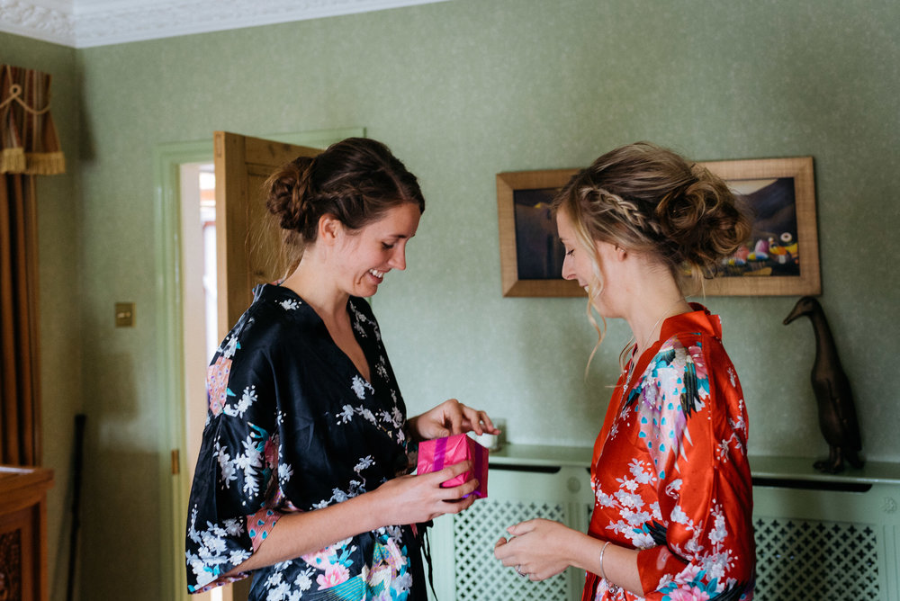 bride giving her maid of honour a gift