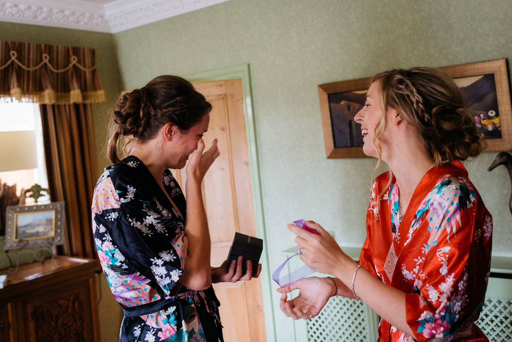 Maid of honour crying as she receives a gift