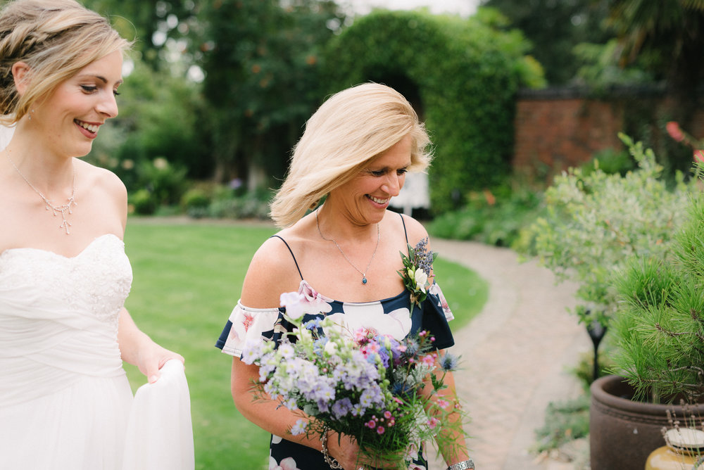 Bride and her mother smiling