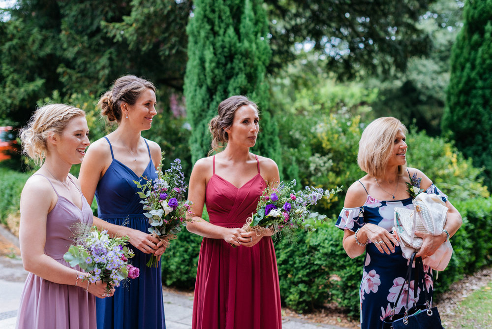 Flower girls waiting for the bride to arrive at Risley Hall