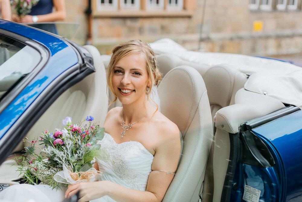 Bride arrives in her fathers Jaguar car