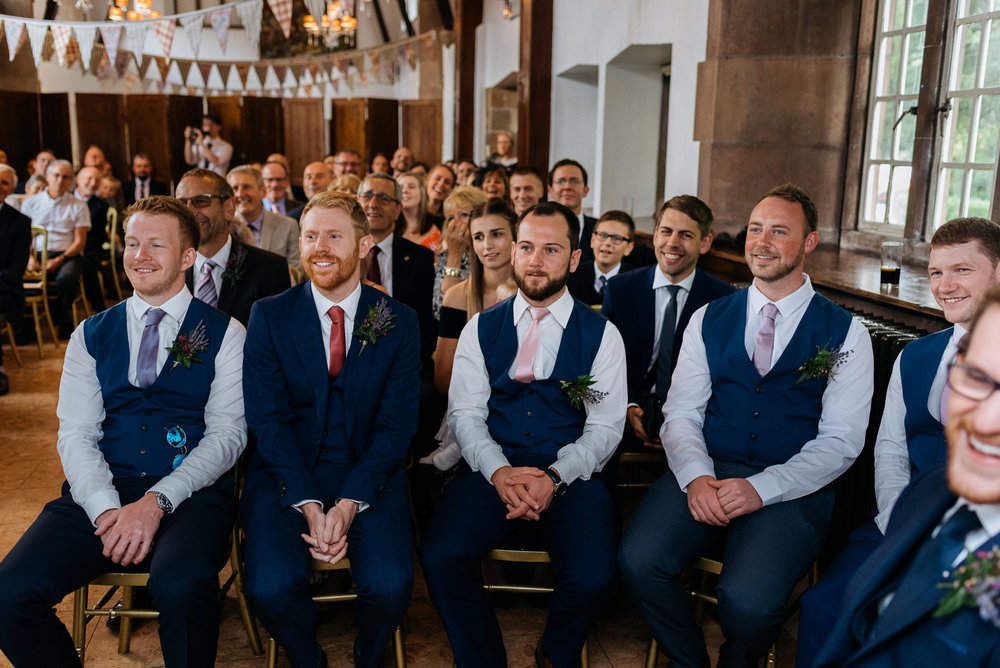 Groomsman at the wedding ceremony at Risley Hall