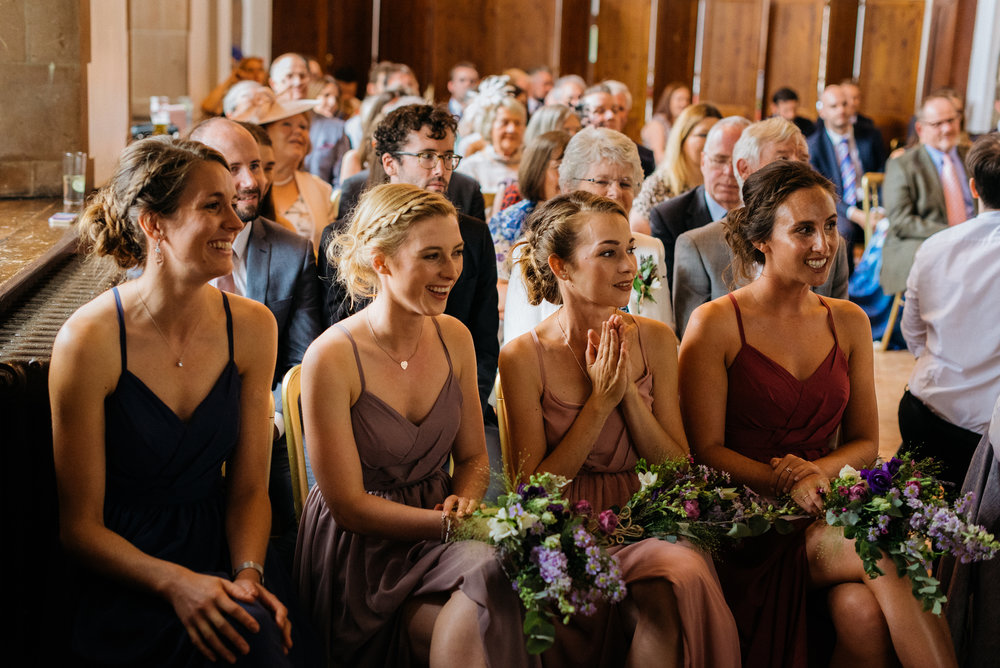 Bridesmaids enjoying the cereony
