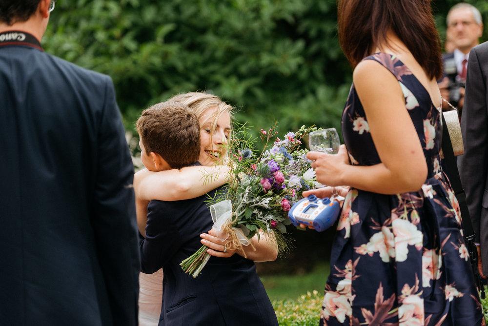 Bride hugs a young guests