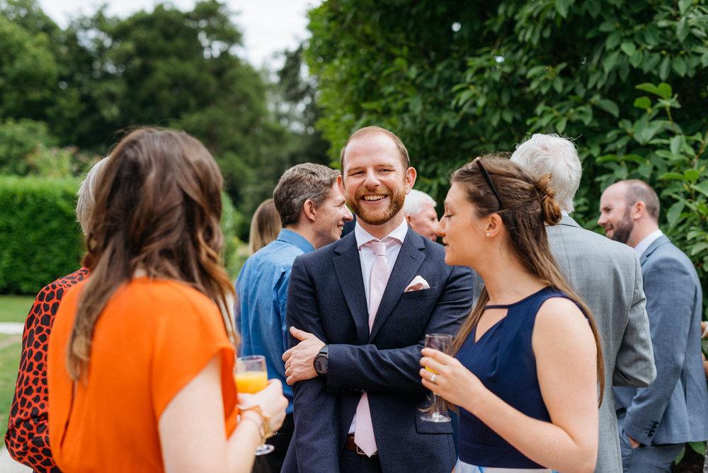 Guests sharing a joke at the wedding