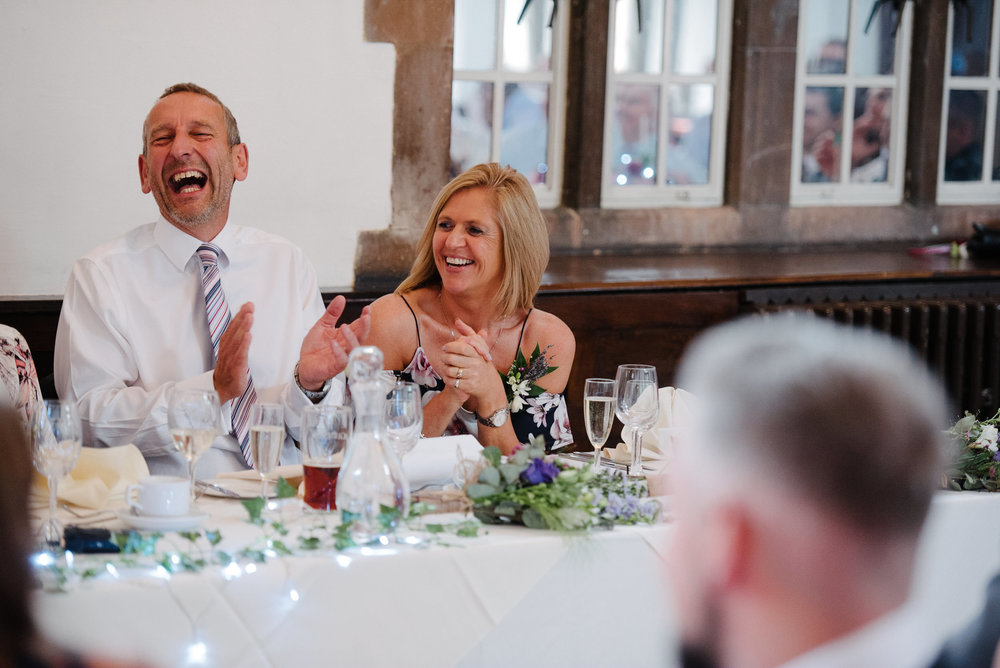 Brides mother laughing at the grooms speech