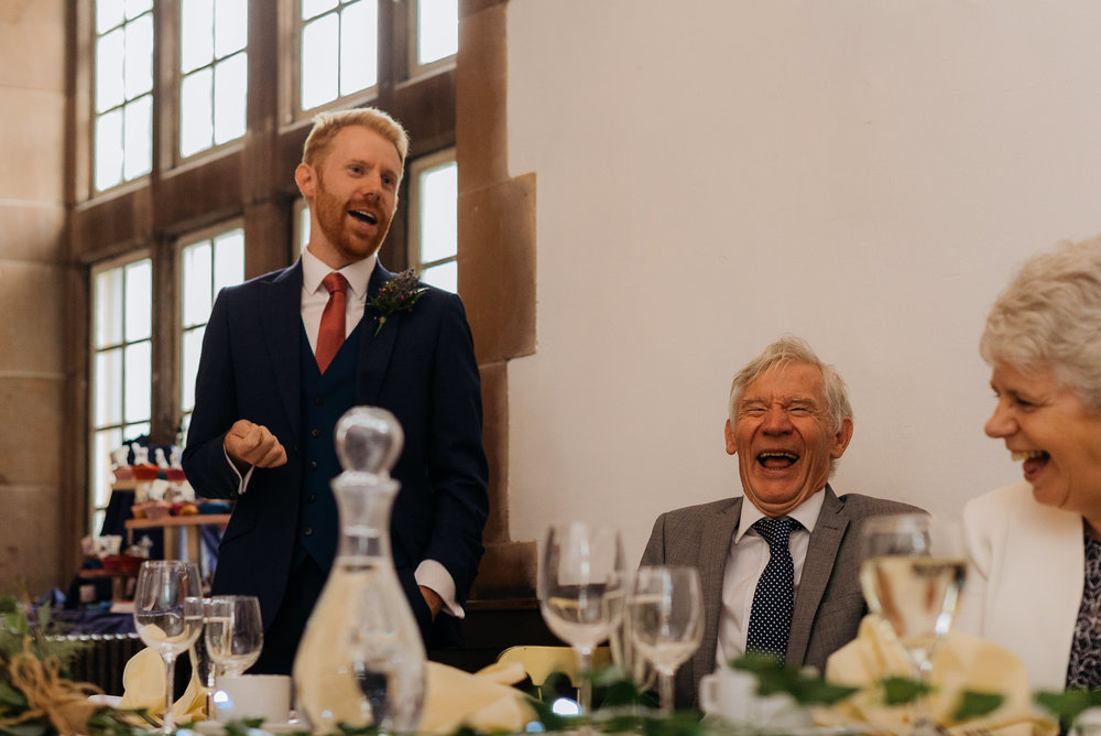 The bestman entertaining the guests as he does his speech