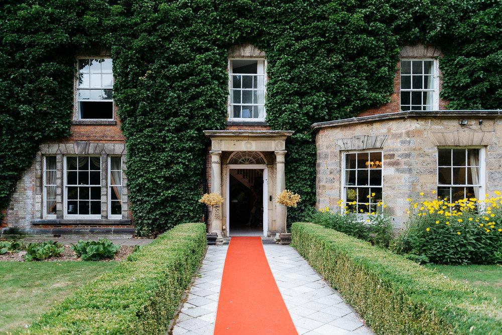 Red carpet at Risley Hall wedding