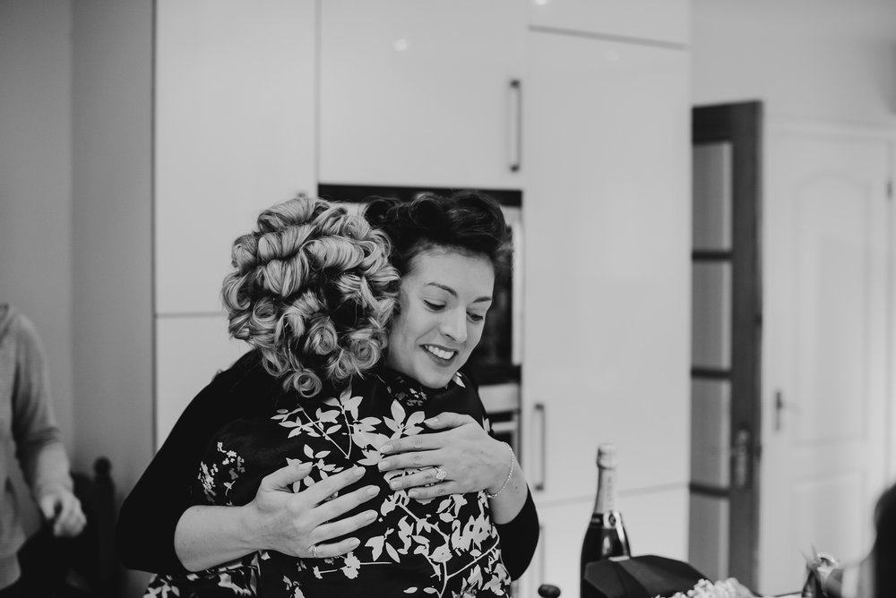 Bride hugging black and white photo