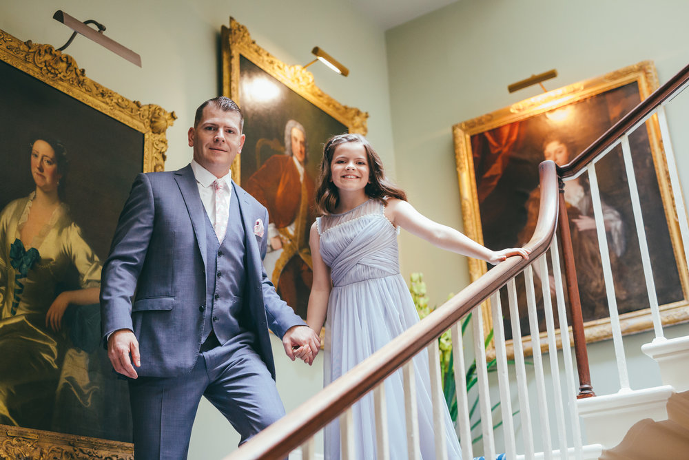 Groom and his daughter on the stairs at Norwood park