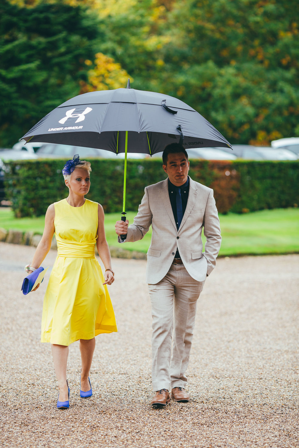 Wedding guests in the rain at Norwood Park