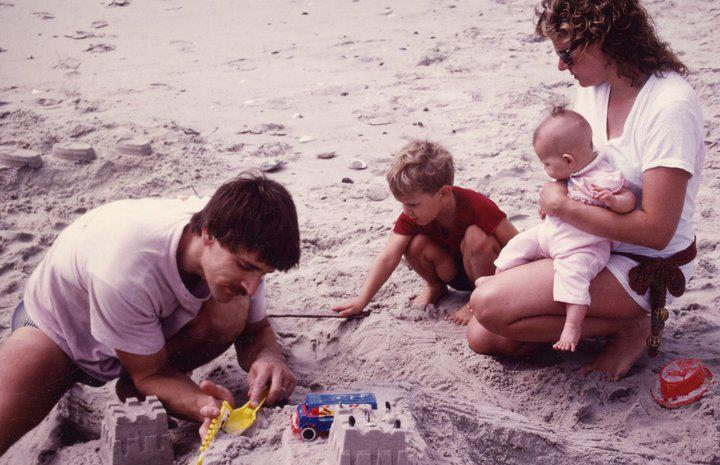 My mom and first dad with my sister and me in Long Beach Island, NJ, 1984.