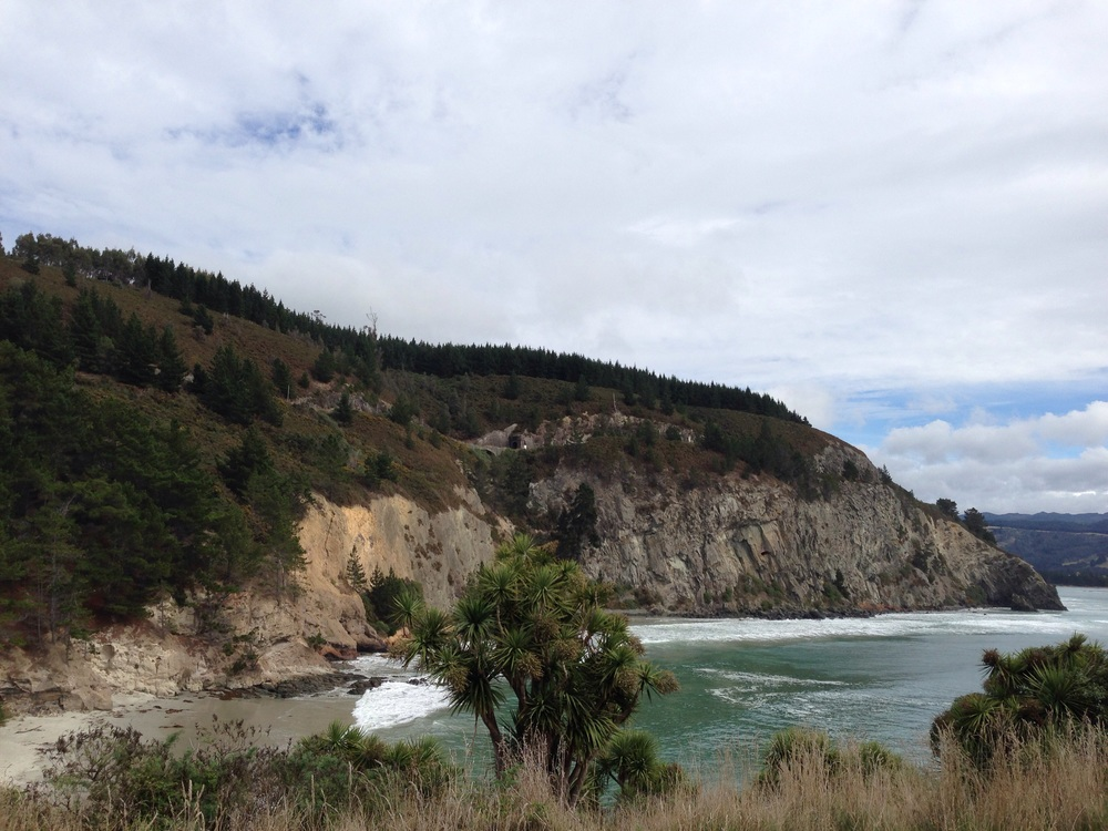 The Arches and Doctors Point beach  on the other side of the cliff.