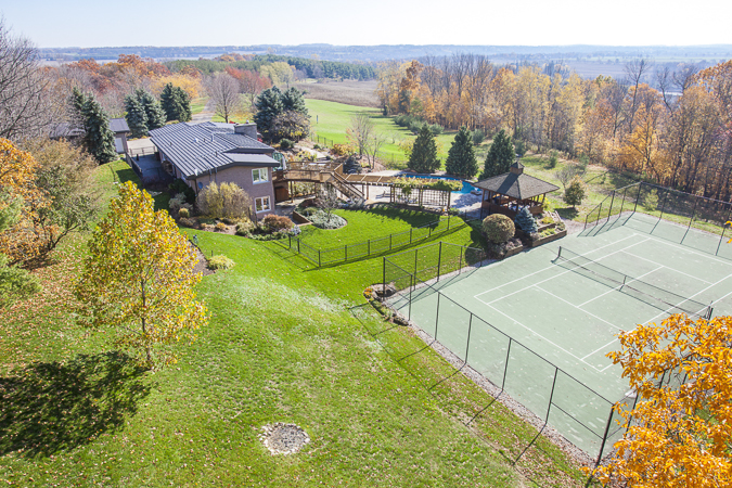 Large property with a scenic country view and tennis court.