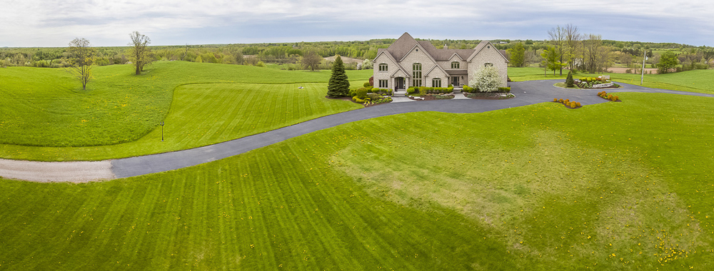 Elevated photo of a luxury country home in Ontario.