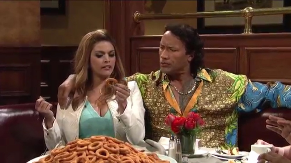 "Cecily Strong and Dwayne Johnson in ""Dinner Date"", written by Strong, James Anderson and Kent Sublette."