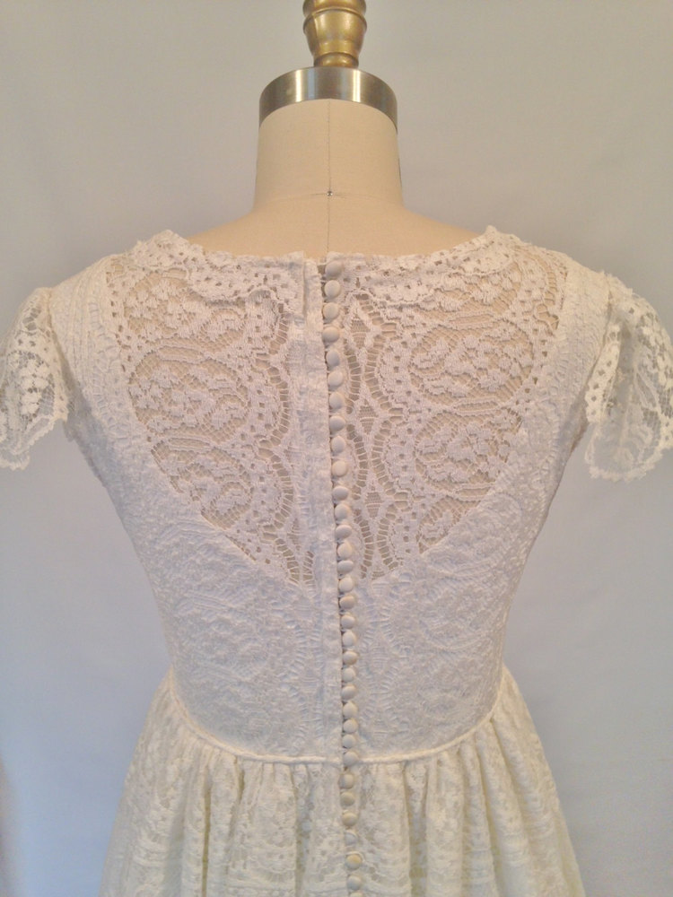 White lace restored wedding dress with flutter sleeves and button ...