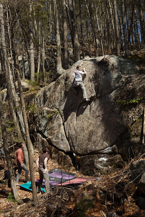 Marc Troob on a high V3 first ascent at Beach Pond in Southern RI.  Photograph by Chris Motta.