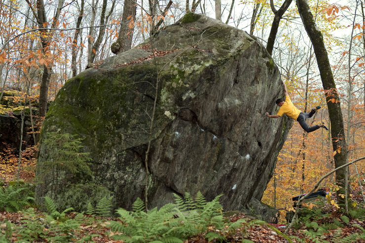 Live Free or Die, V7, at Green Lakes Boulders, Caroga Lake, NY.  Photo by Justin Sandford.