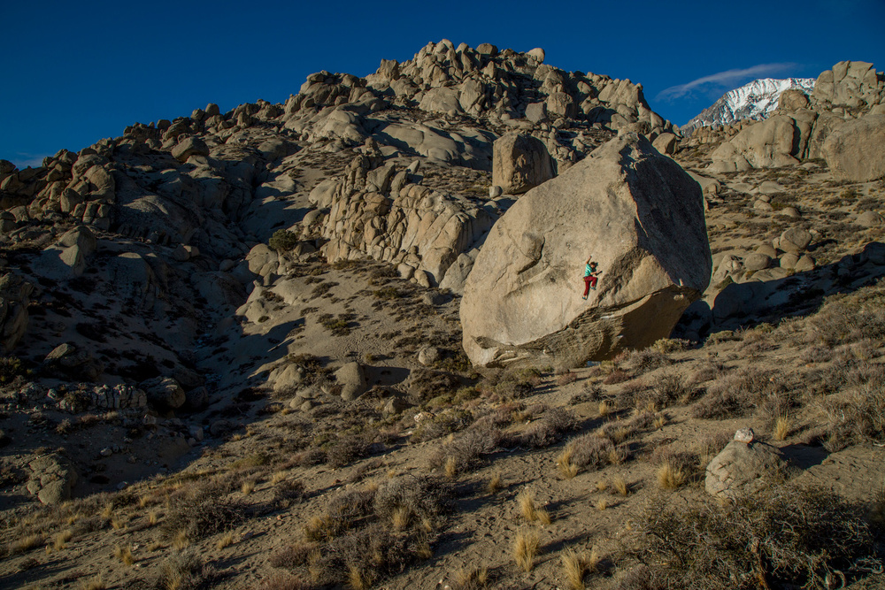 Josh topping out Spectre, Bishop, CA.  Photograph by Dan Krauss.