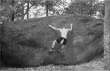 Ed Sewall bouldering on the Whitey Whale (the classic  Slick 50  is just to the right of this photo). This boulder is now covered with graffiti.