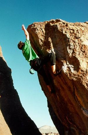 Matt Wilder sending Flying Marcel, V10 at Hueco Tanks.  Photograph by Dan Knights.